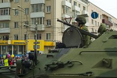 Armored personnel carrier with a crew on a city street after the Victory Day parade. Perm, Russia - May 09, 2018: BTR-82 armored personnel carrier with a crew on Stock Photo