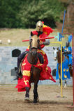 Armored rider with lance. On horse stock image