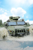 Armored troop-carrier in water Royalty Free Stock Images