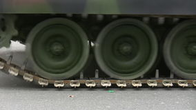 Armored vehicle moving. Closeup of moving continuous tracks of tank on a military parade in the city stock video footage