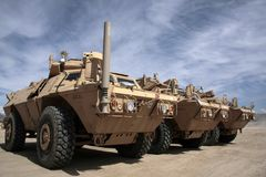 Armored Vehicles Ready for Issue in Afghanistan. Rows of Mine Resistant Ambush Protected Vehicles are staged to be issued to units in Afghanistan Stock Photography