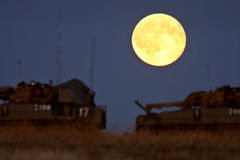 Armored vehicles under a full moon Royalty Free Stock Photos
