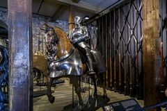 The Armory Chamber of Henry VIII in the Tower of London. LONDON, GREAT BRITAIN - MAY 16, 2014: This is a royal knight`s armor in the Armory Chamber of Henry VIII Royalty Free Stock Images