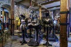 The Armory Chamber of Henry VIII in the Tower of London. LONDON, GREAT BRITAIN - MAY 16, 2014: This is a royal knight`s armor in the Armory Chamber of Henry VIII Stock Photos