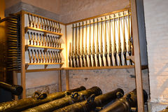Armory in england keep with rifles and canons Stock Image