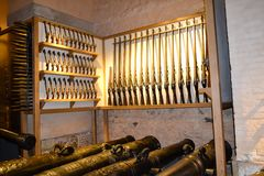 Armory in england keep with rifles and canons Stock Images