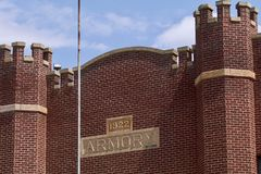Armory. The old brick armory building was built in 1922 and has a flag pole in front Royalty Free Stock Photos