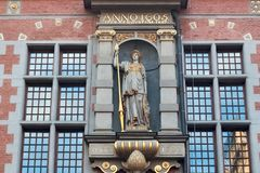 GDANSK, POLAND - JUNE 07, 2014: Detail with sculpture of the Roman goddess Minerva on the Great Armory building in Gdansk. The Armory was erected in the years Stock Photo