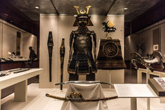 Samurai armour and helmet. The armour is a collection of different pieces made between 1500 and 1800. The small metal  plates are tied with silk and protect Stock Photos