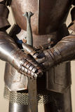 Armour. Of the medieval knight metal sword Royalty Free Stock Photography