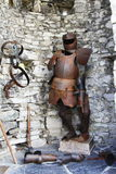 Armour and weapons on the walls. In a small open tower at a corner of the walls of Vezio Castle, near Varenna on Como Lake, you can find these ancient pieces of Royalty Free Stock Images
