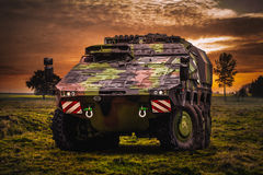 Armoured fighting vehicle. In a beautiful landscape Royalty Free Stock Image