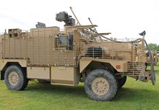 Armoured Heavy Vehicle. A Khaki Coloured Military Armoured Heavy Vehicle Royalty Free Stock Image