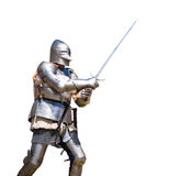 Armoured knight. In attacking position. White background Royalty Free Stock Images