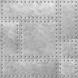 Armoured metal plates with rivets seamless background or texture 3d illustration. Armoured metal plates with rivets seamless background Royalty Free Stock Photos