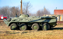 Armoured personnel carrier. An old Soviet Armored troop-carrier on the street Royalty Free Stock Photo