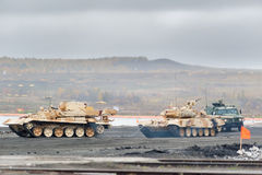 Armoured recovery vehicle BREM-1M evacuates tank Royalty Free Stock Photo
