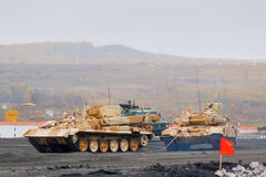 Armoured recovery vehicle BREM-1M evacuates tank Stock Image