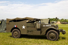 Armoured troop carrier. WESTERNHANGER, UK - JULY 20: An ex US army armoured troop carrier and command car stands on static display for the public to view at the Royalty Free Stock Photography
