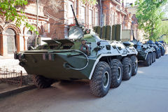 Armoured troop-carrier wheeled. In city Royalty Free Stock Images