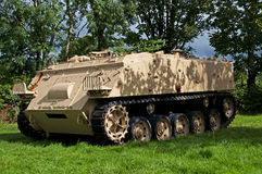 Armoured Vehicle. An FV432 Armoured Personnel Carrier (APC) standing in the shade of a small forest Stock Photos