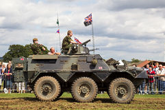Armoured vehicle. HEADCORN, UK - AUGUST 16: A vintage ex British army Paladin armoured car gives a demonstration in the main show arena at the Combined-Ops Royalty Free Stock Image