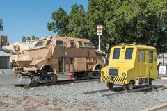 Armoured vehicle on rails and rail track inspection car, Windhoe. WINDHOEK, NAMIBIA - JUNE 17, 2017: An armoured vehicle on rails and a rail track inspection car Royalty Free Stock Photo