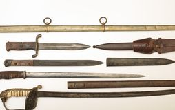 Armoury display of historic swords and daggers. Armoury display of historic swords, knives and daggers in a close up overhead partial view on the handles and stock photo
