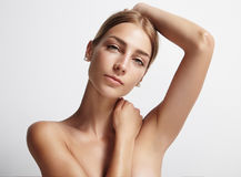 Armpit care of woman. Woman showing her armpit and looking at camera Royalty Free Stock Photo