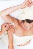 Armpit deplication. Mid-adult woman having an armpit depliation royalty free stock photo