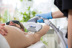 Armpit laser epilation at beautician`s Stock Photo