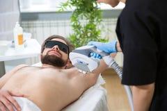 Armpit laser epilation at beautician`s Stock Photos