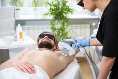 Armpit laser epilation at beautician`s Royalty Free Stock Images