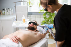 Armpit laser epilation at beautician`s Stock Images