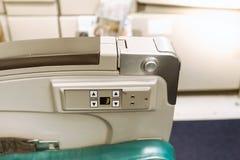 Armrest στο κάθισμα αεροπλάνων με τα κουμπιά Στοκ φωτογραφία με δικαίωμα ελεύθερης χρήσης