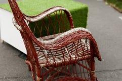 Armrest της ψάθινης καρέκλας Στοκ Φωτογραφίες