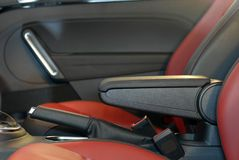 Armrest of the car and handbrake Royalty Free Stock Photography