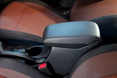 Armrest of the car and handbrake. Detail in the interior of the modern car Stock Photography
