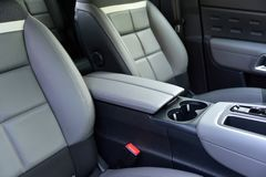 Free Armrest In The Luxury Passenger Car Between The Front Seats Stock Photo - 167953810
