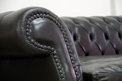 Armrest leather sofa Royalty Free Stock Photography