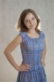 Arms akimbo. Girl in blue dress standing arms akimbo Royalty Free Stock Photos