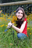 Arms around wildflowers Stock Photography