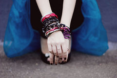 Arms with bracelets. And ring Stock Photography