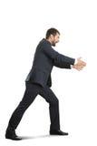 arms businessman his stretching Στοκ φωτογραφία με δικαίωμα ελεύθερης χρήσης