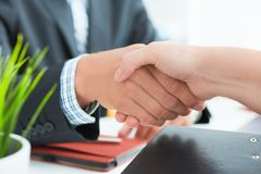 Arms of businessman and woman shaking hands as hello in office closeup. Friend welcome, introduction, greet or thanks. Businessman and woman shake hands as hello royalty free stock photography