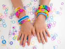 Arms of a child wearing multicoloured bracelets Royalty Free Stock Photos