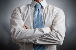 Arms Crossed. Image of a man wearing a tie with his arms crossed Stock Photography