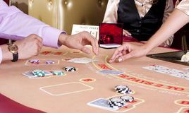 Arms dealer and the player to the game table Royalty Free Stock Photography