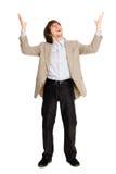 arms den lyftta lyckliga mannen för affären Fotografering för Bildbyråer