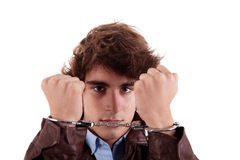 Arms on the face, of a young man, with a handcuffs. On the hands, isolated on white background Stock Image